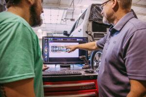 mechanics running diagnostics on a car